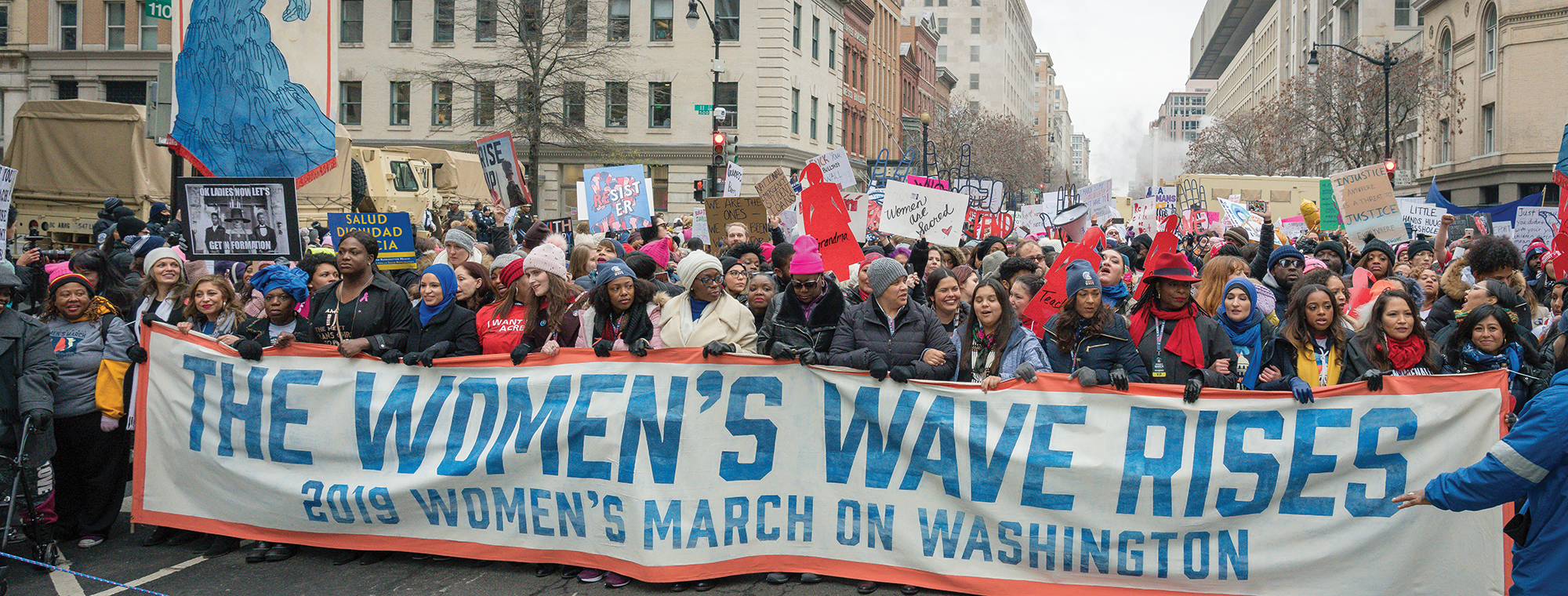 Marchers carrying the 'women's wave' sign at the 2019 Women's March, Washington, DC. Image: Mobilus In Mobili, Flickr