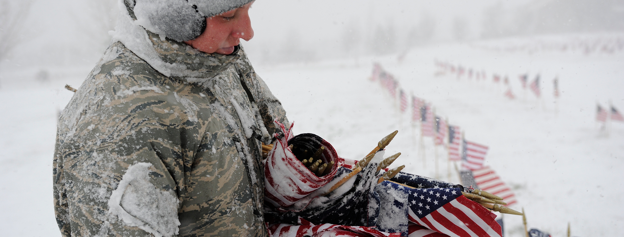 US Air Force Tech. Sgt. Sara Bauer, 388th CMS, holds a bunch of American flags during a volunteer opportunity at the Veterans Memorial Park, Bluffdale, Utah, Nov. 9, 2012